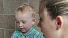 Mother and son playing with plasticine and talking Stock Footage