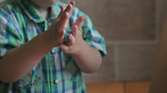 Little boy close up hands, play with plasticine Stock Footage
