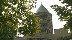 View of a beautiful castle through the branches of the trees Stock Footage