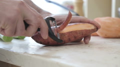 peeling sweet potato - stock footage