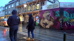 Tourist walking in rainy day at downtown in Reykjavik,tiger graffiti,iceland Stock Footage