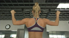 Young woman pulls on the bar Stock Footage