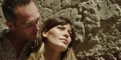 Couple romancing outdoors on a sunny day - stock footage