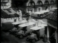 Recreation of World War I Red Cross ambulances leaving hospital Stock Footage