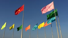 Flags on windy blue sky background Stock Footage