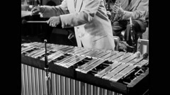 Medium shot of musician playing xylophone on stage, 1950s - stock footage