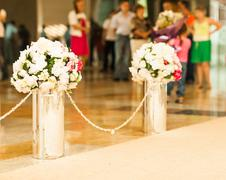 Beautiful wedding flower arrangement of seats along the aisle Stock Photos