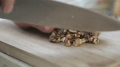 Chopping walnut on a wooden board Stock Footage