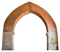 Brick pointed arch in an ancient Benedictine monastery. Stock Photos