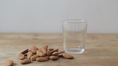 Pouring a glass of almonds milk Stock Footage