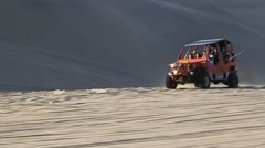 Tourists on sand dune buggy trip Stock Footage