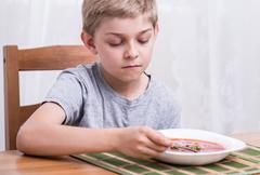 Stock Photo of Schoolboy with no appetite