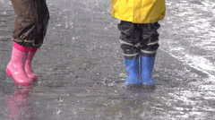 Kids in the Rain Stock Footage