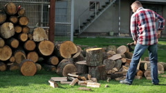 Man chopping wood in the homestead Stock Footage