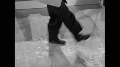 Low angle view of tap dancers legs as he dances on wooden floor, 1950s Stock Footage