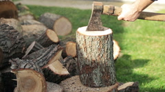 Male hands chopping wood in the garden Stock Footage