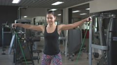 Athletic muscular girl athlete performs exercises at the gym using equipment Stock Footage