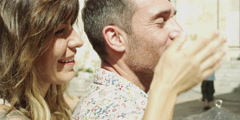 Woman covering husband eyes Stock Footage