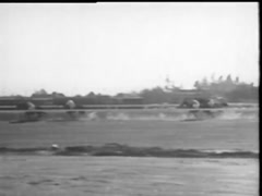 Long shot of six jockeys on horses galloping on race track, 1940s Stock Footage