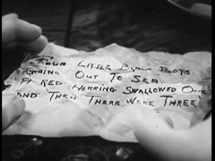 Closeup of hands holding crumpled note, 1930s Stock Footage