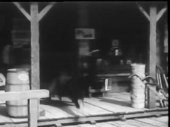Rear view of man stumbling and getting up in front of saloon entrance, 1940s Stock Footage