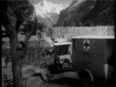 Historical reenactment of  World War I military ambulances leaving base, 1930s Stock Footage