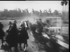 Front view of jockeys on horses galloping on race track, 1940s Stock Footage