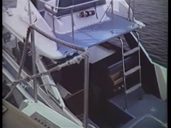High angle view of speedboat  leaving dock, 1970s Stock Footage