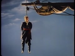 17th century reenactment of man hanging from ship mast Stock Footage