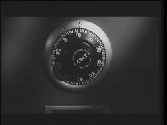 Closeup of combination lock on safe spinning by itself, 1960s Stock Footage