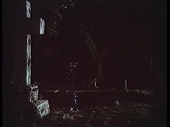 Glowing figure materializing in cemetery, 1970s Stock Footage