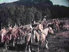 Reenactment of American Indians on horseback preparing for battle Stock Footage
