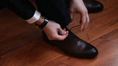Close up of man leg and hands tying shoe laces Stock Footage