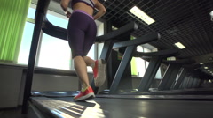 young woman running on treadmill - stock footage