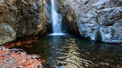 Millomeri waterfall and stream in the forest at Troodos mountains Stock Footage
