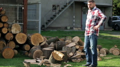 Young funny man talking to the camera after chopping wood in homestead Stock Footage