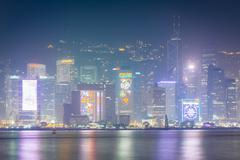 View of modern skyscrapers on Hong Kong Island at night, from Tsim Sha Tsui,  - stock photo