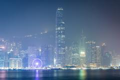 View of modern skyscrapers on Hong Kong Island at night, from Tsim Sha Tsui,  Stock Photos