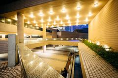 The exterior of the Hong Kong Cultural Centre at night, in Kowloon, Hong Kong Stock Photos