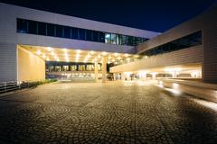 The exterior of the Hong Kong Cultural Centre at night, in Kowloon, Hong Kong - stock photo
