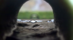 Inside canalization - Water flowing inside old pipe - slow motion, close up shot - stock footage
