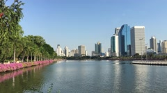 Lake with skyscrapers at Benjakitti Park in Bangkok Stock Footage
