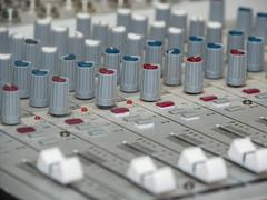 part of an audio sound mixer with buttons - stock photo
