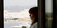 Stock Video Footage of Young woman drinking morning coffee in balcony