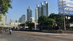 Road next to the Benjakitti Park in Bangkok Stock Footage