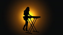 Female keyboard player backlit Stock Footage