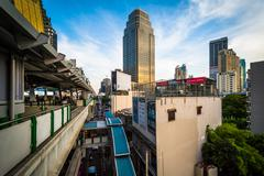 Modern skyscrapers and skytrain platform in the Sukhumvit district, in Bangko - stock photo