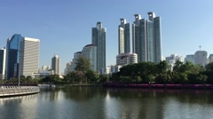 Lake with skyscrapers at Benjakitti Park Stock Footage