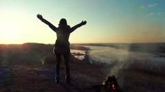 Happy woman open arms under the sunset on a hill HD Stock Footage