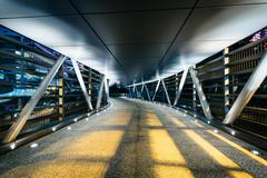 Stock Photo of Covered pedestrian bridge at night, in Hong Kong, Hong Kong.